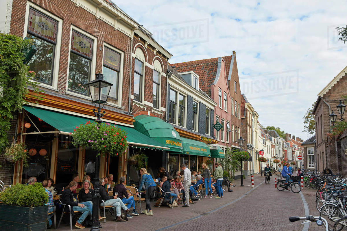 People sitting outside Springhaver Theater in Utrecht, North Holland, The Netherlands, Europe Royalty-free stock photo
