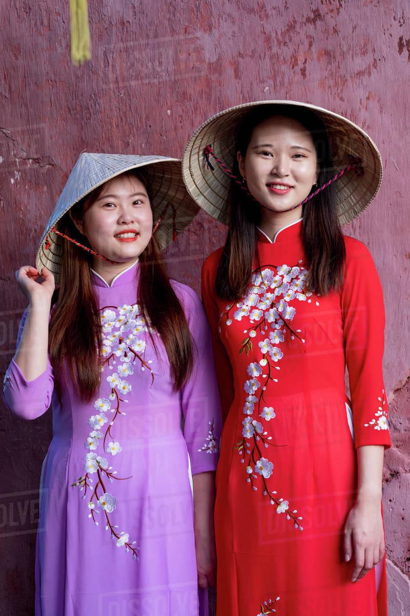 Young Vietnamese women wearing a traditional Ao Dai dress, Vietnam, Indochina, Southeast Asia, Asia Royalty-free stock photo