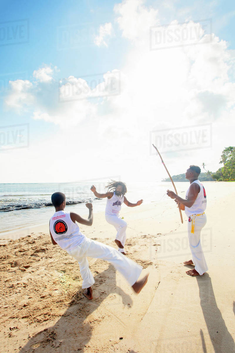 Local people playing capoeira on the beach, Boipeba Island, Tinhare, Brazil, South America Royalty-free stock photo