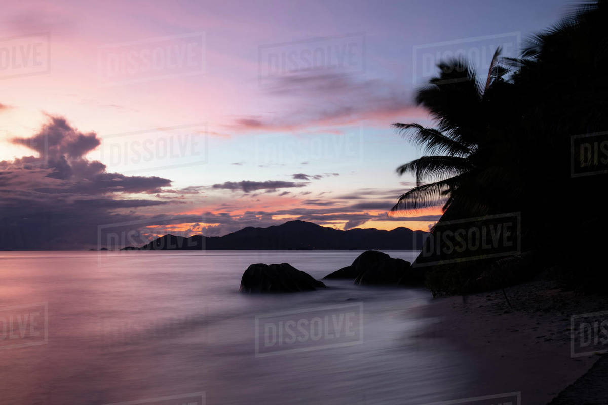 Sunset at Anse Source d'Argent looking toward Praslin, Union Estate Park, La Digue, Seychelles, Indian Ocean, Africa Royalty-free stock photo
