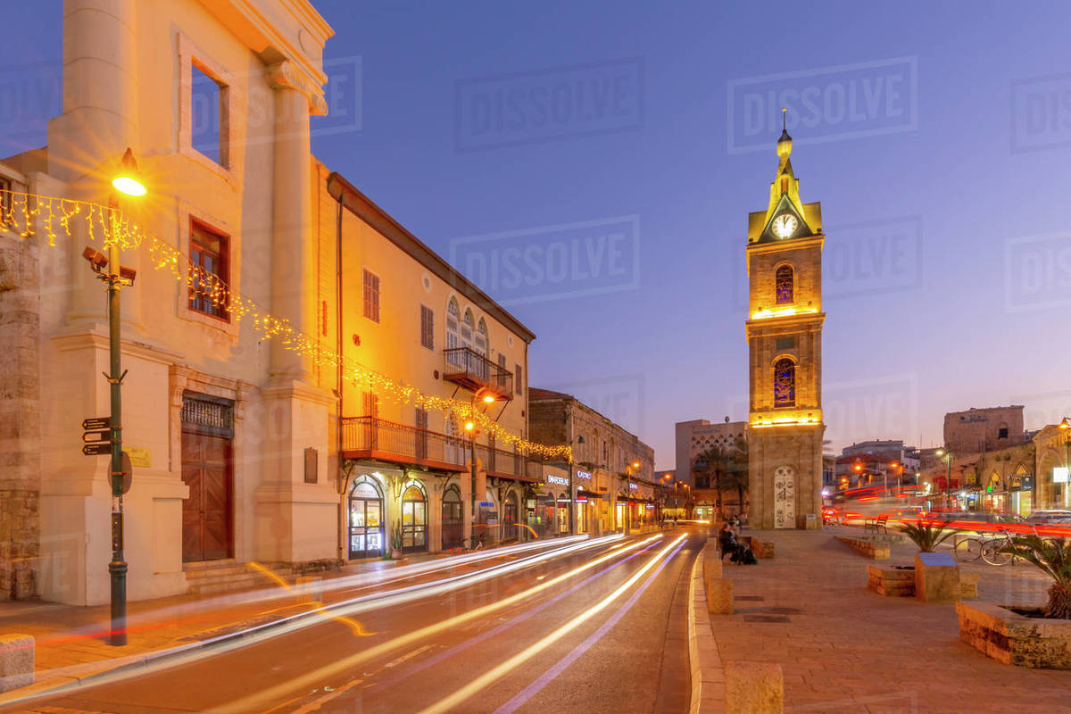 View of The Clock Tower and trail lights at dusk, Jaffa Old Town, Tel Aviv, Israel, Middle East Royalty-free stock photo