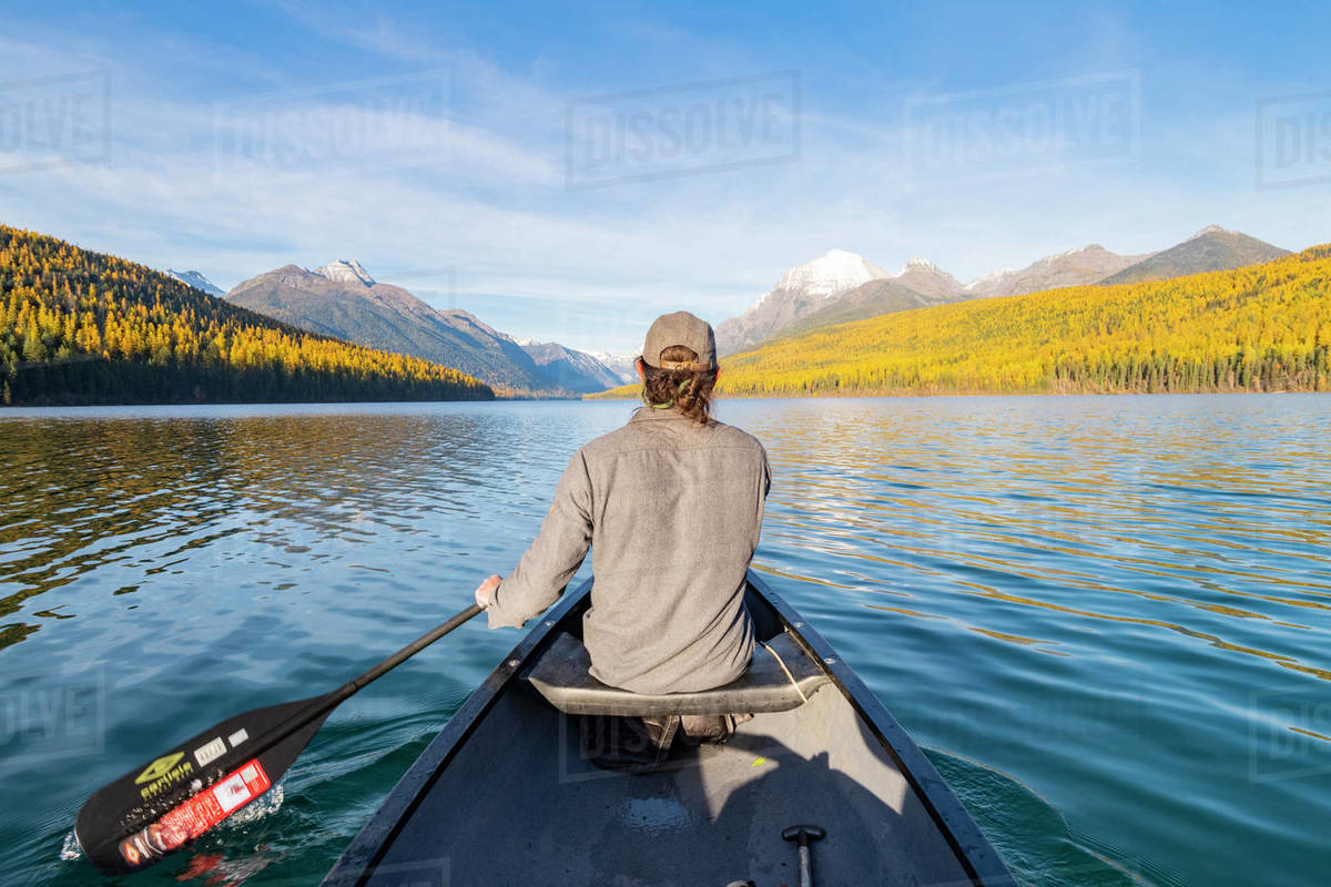 Canoeing across Bowman Lake, Glacier National Park, Montana, United States of America, North America Royalty-free stock photo