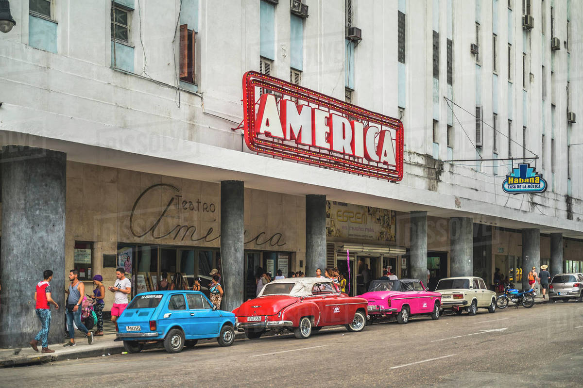 Old vintage cars parked outside Teatro America, La Habana (Havana), Cuba, West Indies, Caribbean, Central America Royalty-free stock photo