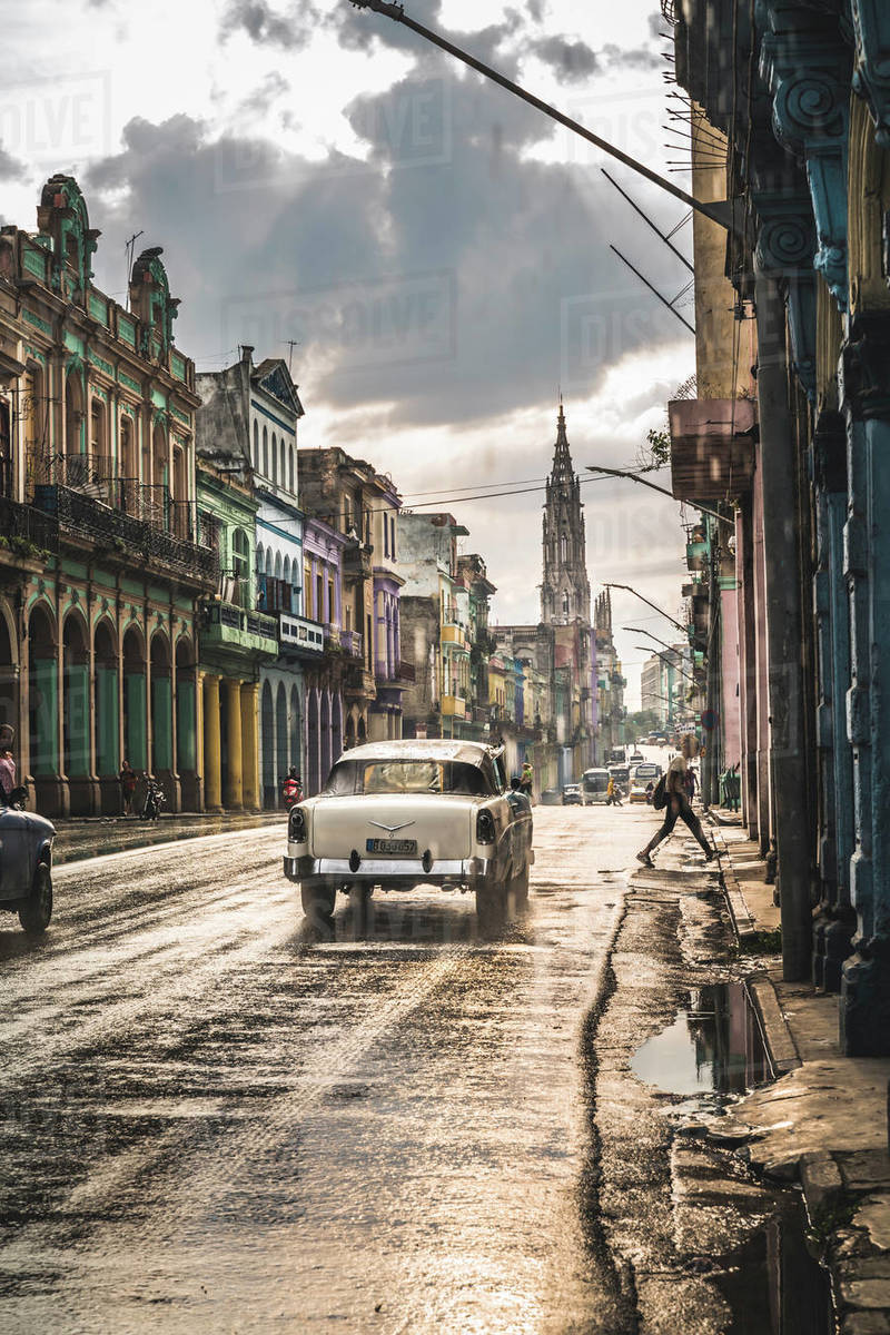 Typical street in La Habana and cathedral in the distance in rain, Havana, Cuba, West Indies, Caribbean, Central America Royalty-free stock photo