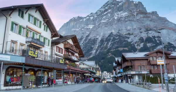 Traffic in Grindelwald village and the Schreckhorn, Jungfrau region, Bernese Oberland, Swiss Alps, Switzerland, Europe Royalty-free stock video