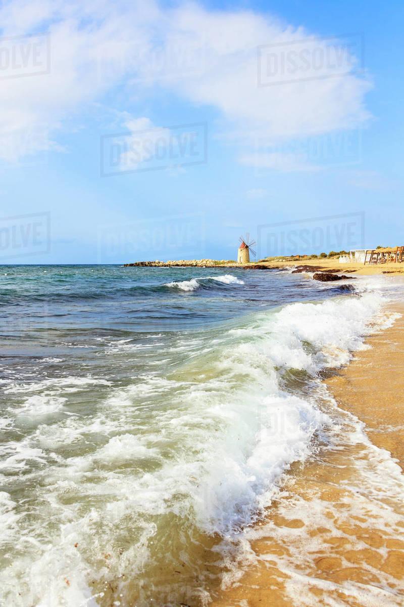 Sea waves crashing on sand beach of Baia dei Mulini, Trapani, Sicily,  Italy, Mediterranean, Europe stock photo