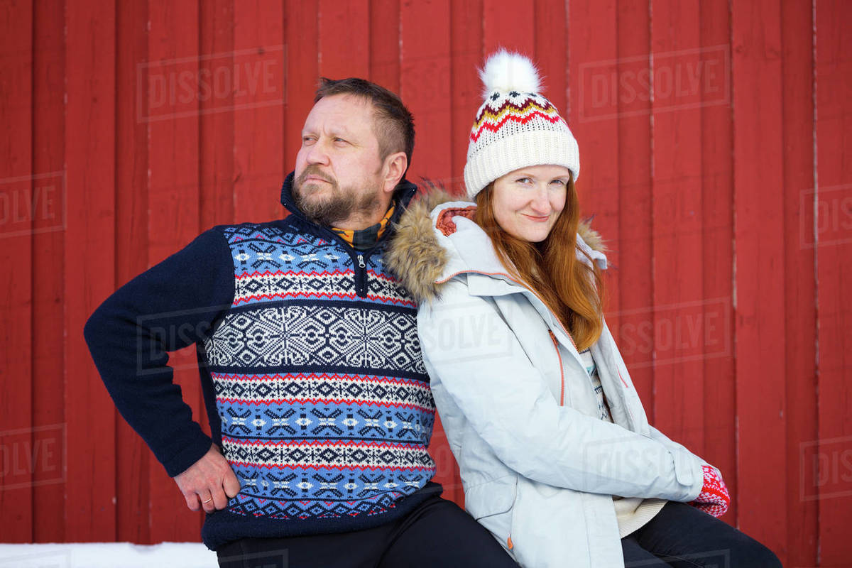 Happy family trip to lofoten islands. couple man and girl fun posing for the camera. Norway Royalty-free stock photo