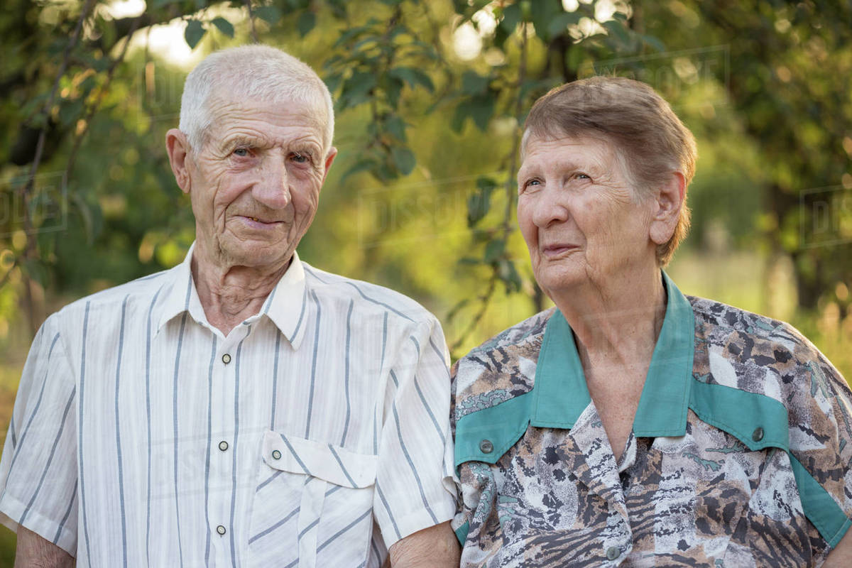 Married couple. smiling grandparents. portrait of smiling senior man and senior woman at the garden. happy old age Royalty-free stock photo