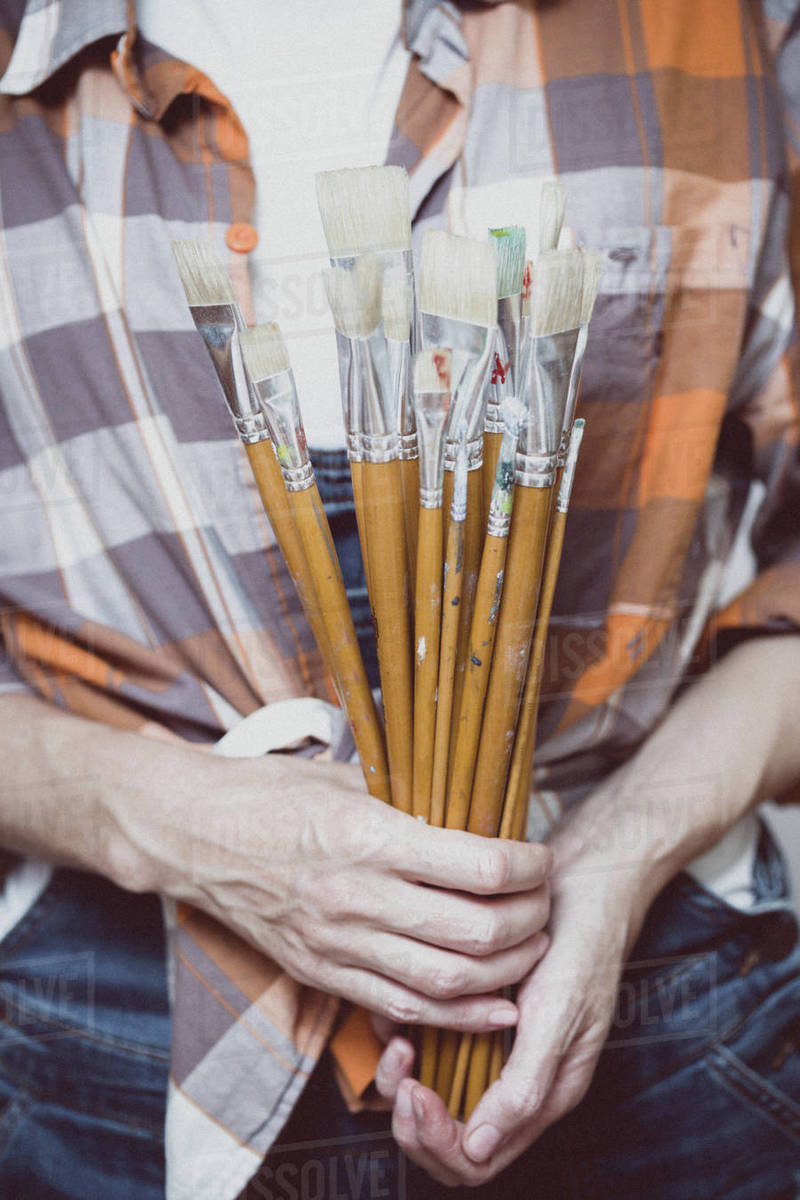 Time of creativity. girl painter holds a brush Royalty-free stock photo