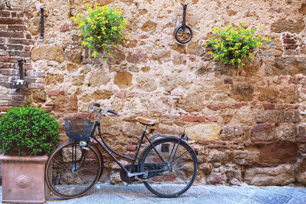 Bike standing at the empty street of old italian town. Pienza, Tuscany, Italy Royalty-free stock photo