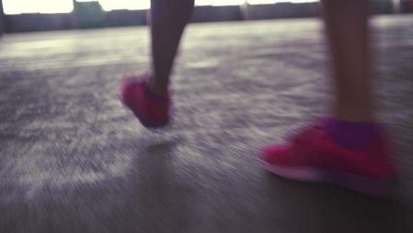 Feet with sneakers walking on concrete floor Royalty-free stock video