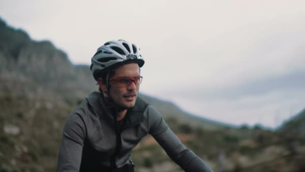 Professional cycling sport enthusiast with proper protective wear and bicycle focused on his exerciseand training on an overcast day Royalty-free stock video