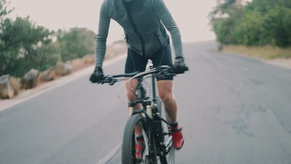 Cyclist in race ready for action with all his protective wer for his professional sport on an overcast day Royalty-free stock video