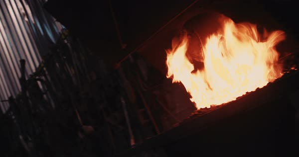 Close-up of furnace in blacksmith workshop with flames in slow motion Royalty-free stock video