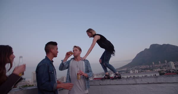 Hipster woman balancing on the edge of rooftop Royalty-free stock video