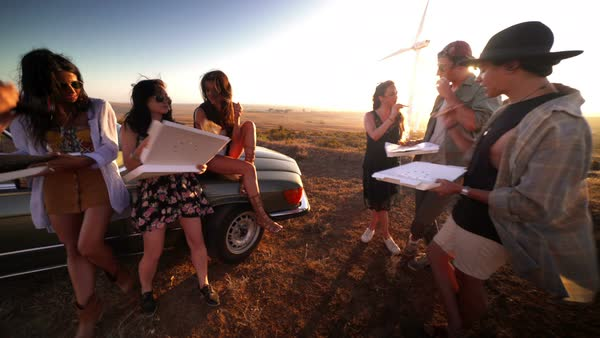 Group of young adult women eating pizza in summer at sunset Royalty-free stock video