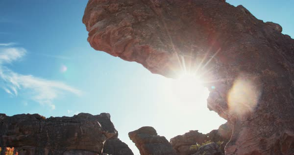 Establishing shot of rocks in the nature with sunflare at daytime Royalty-free stock video