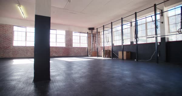 Establishing shot of a empty crossfit gym with sunflare Royalty-free stock video