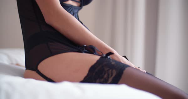 Beautiful brunette woman in sexy lingerie sitting on bed Royalty-free stock video