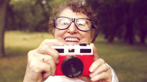 Grandma with retro camera Royalty-free stock video