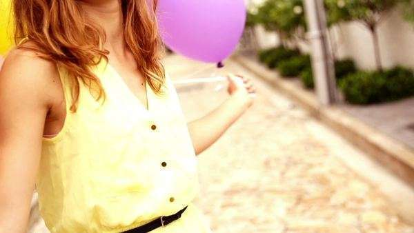 Close-up of teenage girl playing with colorful balloons in slow motion Royalty-free stock video