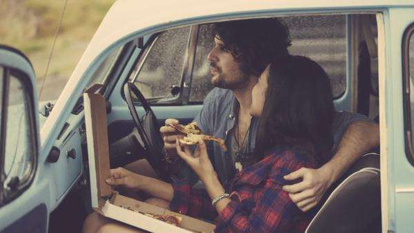 Couple eating pizza in retro car Royalty-free stock video