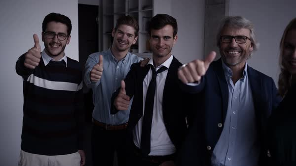 Positive office workers showing thumbs up to camera Royalty-free stock video