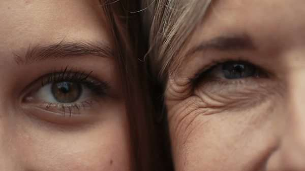 Close-up on eyes of mother and daughter faces next to one another Royalty-free stock video