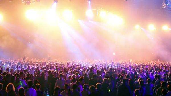 Many people at rave party, crowd dance in blue light of projectors Royalty-free stock video
