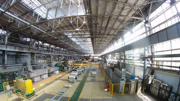 Rolls of aluminum lie in production shop of rolling mill, timelapse Royalty-free stock video