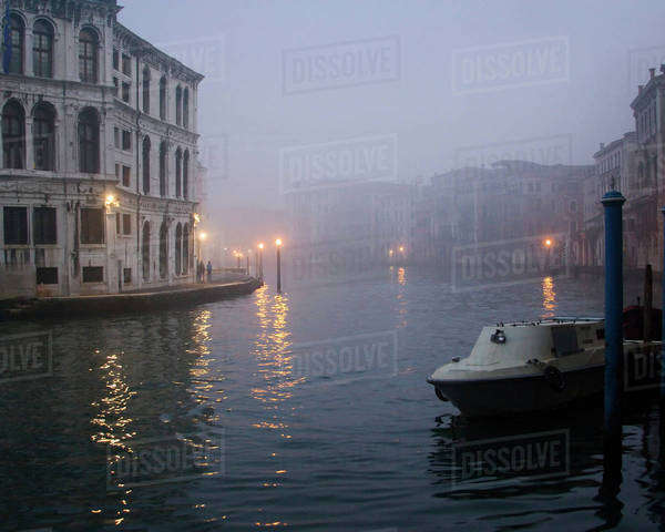 Italy, Venice. Boat moored on Grand Canal in early morning fog. Royalty-free stock photo