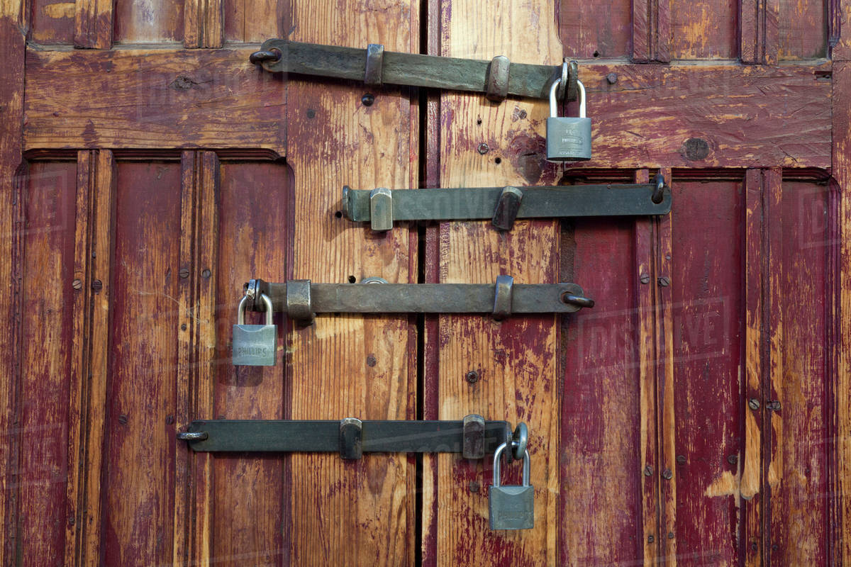 Mexico, San Miguel de Allende. Detail of wooden door with four locks ...