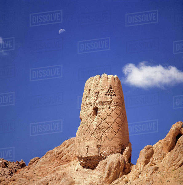 Afghanistan, Bamian Valley. An abandoned watchtower in the City of Noise rises above the Bamian Valley, a World Heritage Site, in Afghanistan. Royalty-free stock photo