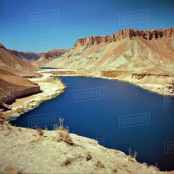 Afghanistan, Band-i-Amir Lakes. The sapphire blue waters of Band-i-Amir Lakes contrast with the arid landscape, in Afghanistan. Royalty-free stock photo