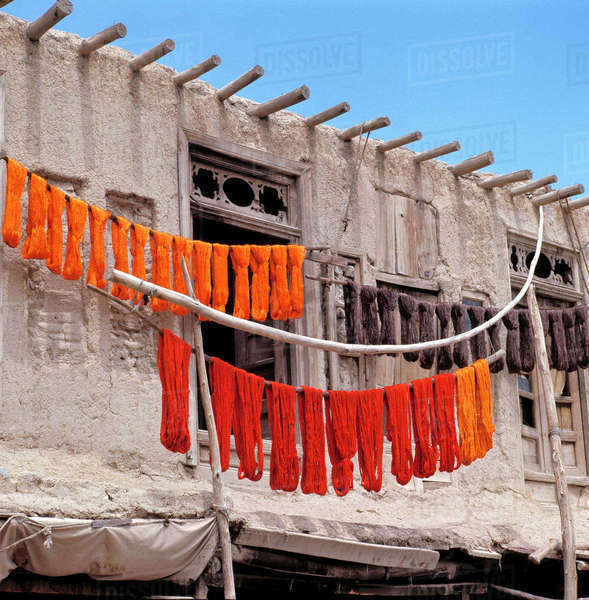 Afghanistan, Ghazni. Brightly-colored dyed wool dries on poles in Ghazni in Afghanistan. Royalty-free stock photo