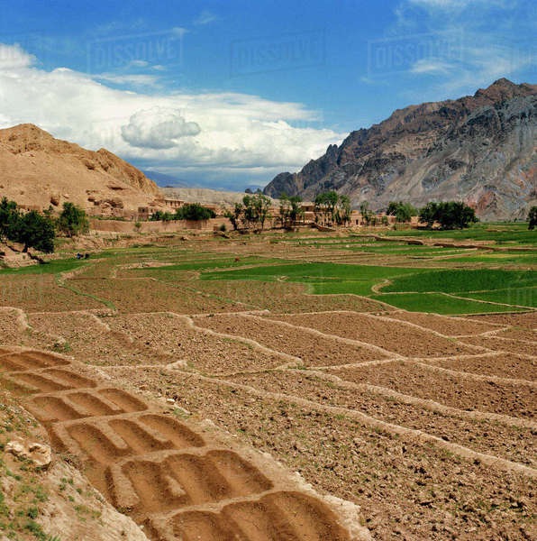 Afghanistan, Shibar Pass. Ancient irrigation techniques retain water for terraces in the arid landscape near the Shibar Pass in Aghanistan. Royalty-free stock photo