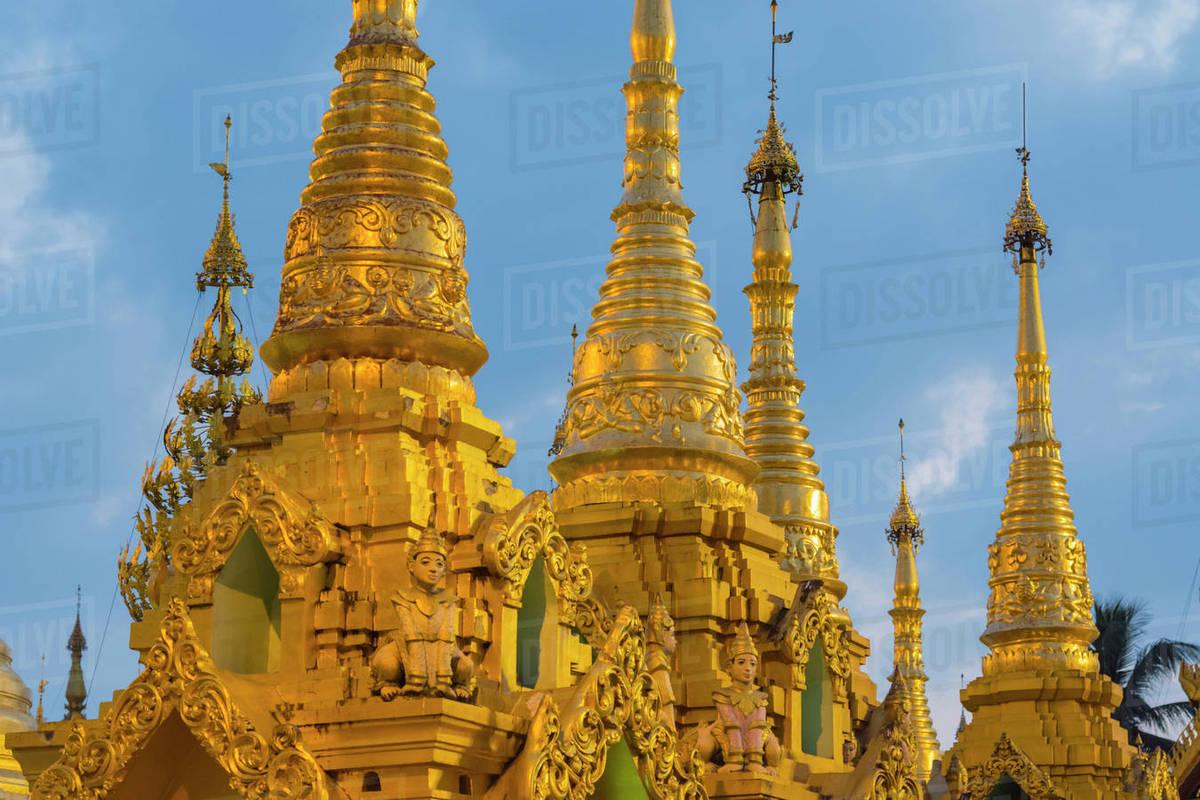 Myanmar  Yangon  Shwedagon Pagoda  Golden spires gleam at twilight  stock  photo