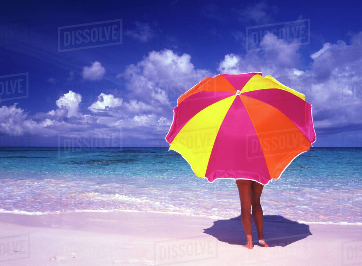 Female Holding A Colorful Beach Umbrella Pink Sand Harbour Island Bahamas