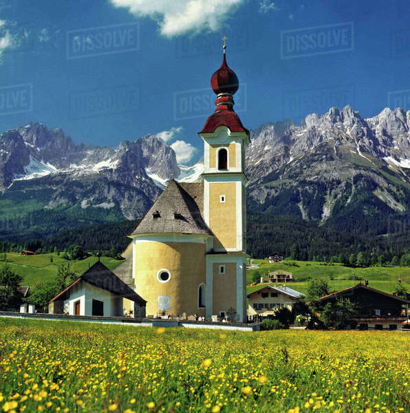 Europe, Austria, Inn River Valley. The charming church at Going in the Inn River Valley, has Austria's Karwendel Alps as a backdrop. Royalty-free stock photo