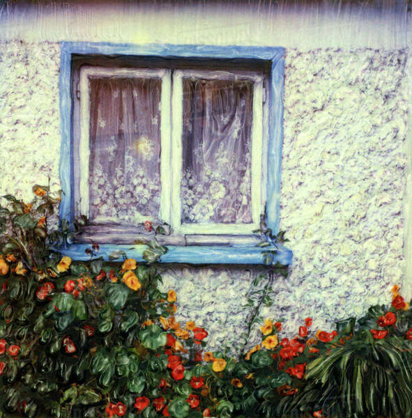 Europe, Ireland, Dingle. Blue framed window on white wall with flowers. Polaroid SX70 Manipulation Royalty-free stock photo