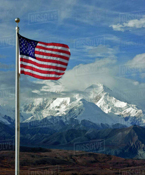 The American Flag waves at Denali (Mt. McKinley), highest mountain in all of North America on Sept. 11, 2011, the tenth anniversary of the 9/11 attacks. Royalty-free stock photo