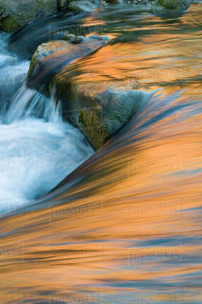 USA, Utah, Zion National Park. Canyon and sky reflections on Virgin River turbulence. Rights-managed stock photo
