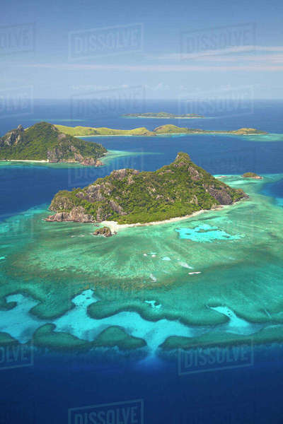 Monuriki Island and coral reef, Mamanuca Islands, Fiji, South Pacific, aerial Rights-managed stock photo