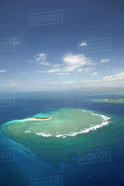 Surf on reef off Namotu Island, and Tavarua Island in distance, Mamanuca Islands, Fiji, South Pacific, aerial Rights-managed stock photo