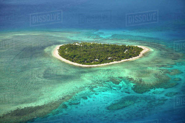 Tavarua Island and coral reef, Mamanuca Islands, Fiji, South Pacific, aerial Rights-managed stock photo