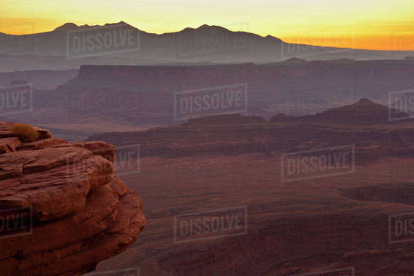 USA, Utah, Dead Horse Point State Park. Misty sunrise over rock formations. Rights-managed stock photo