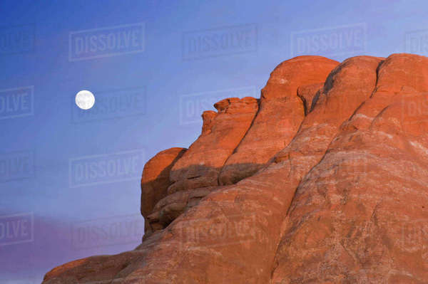 USA, UT, Arches National Park, Moon Rising at Devil's Garden Rights-managed stock photo
