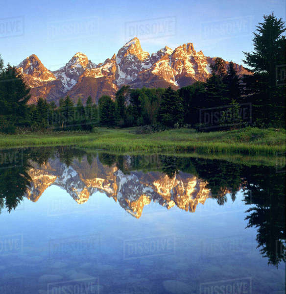 USA, Wyoming, Grand Teton National Park. Grand Teton Mountains reflecting in the Snake River at sunrise. Rights-managed stock photo