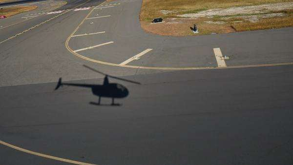 Shadow of a helicopter Takeoff, Honolulu, Airport, Oahu, Hawaii Rights-managed stock video