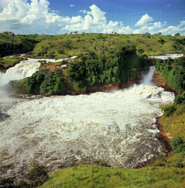 Africa, Uganda, Murchison Falls National Park. The frothy white glory that is Murchison Falls, Murchison National Park, Uganda, is created by the Victoria Nile. Royalty-free stock photo